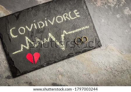 """Great concept of divorce in quarantine due to the 2019 coronavirus pandemic. Plaque written """"COVIDIVORCE"""" in reference to divorces caused by human relationships during quarantine."""