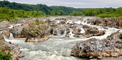Great Falls is a series of rapids and waterfalls on the Potomac River, 14 miles (23 km) upstream from Washington, D.C., on the border of Montgomery County and Fairfax County