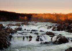 Great Falls on the Potomac near Washington at sunset with the sun illuminating the trees