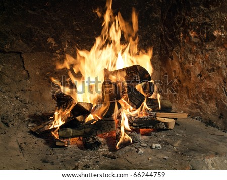 Great glowing fire in a old fireplace