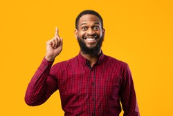 Great Idea Concept. Young Funny African American Man Pointing Finger Up. Excited Black Guy Got Solution To His Problem, Having Aha Moment, Isolated On Yellow Studio Background. Wow, Eureka