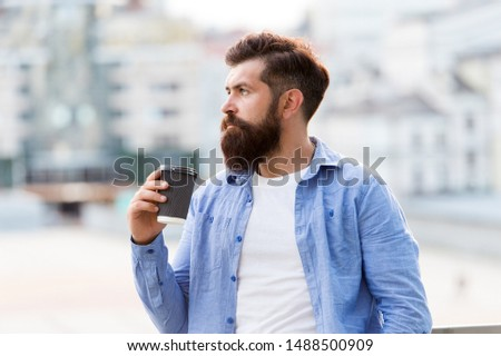 Great ideas come from great coffee. Man drink take away coffee. Morning coffee. Mature hipster enjoy hot beverage. Bearded man relax outdoors. Coffee break concept. Caffeine addicted.
