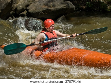 great image of a teenager girl white water kayaking