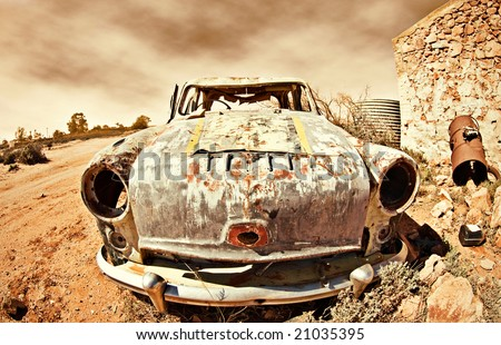 great image of an old car rusting away in the desert