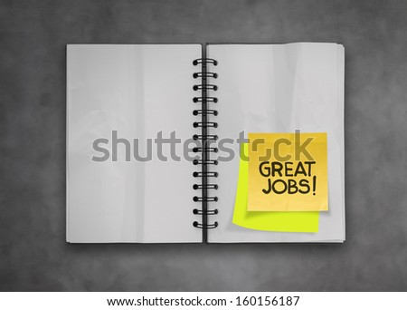 great job word sticky notes with open blank note book on desk top texture