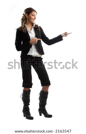 Great looking blond business woman shot in studio - pointing left