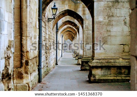Great medieval engineering, looking through the arches underneath the flying buttresses of the Winchester Cathedral, UK #1451368370