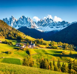 Great morning view of Santa Magdalena village and Chiesa di Santa Maddalena church. Colorful autumn scene of Dolomite Alps, Italy, Europe. Beauty of countryside concept background.