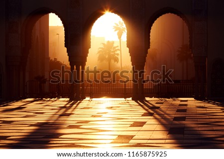 Great mosque of Hassan 2 at sunset in Casablanca, Morocco. Beautiful Arches of the Arab mosque in the sunset, sunlight rays