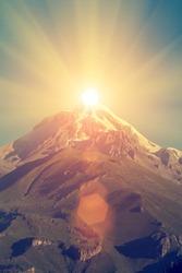 Great mountain peak with sun