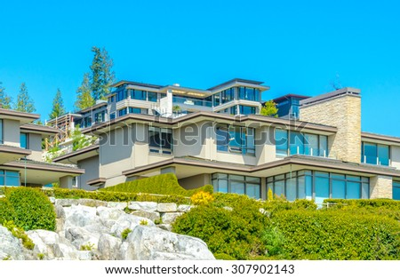 Great neighborhood with custom made luxury modern houses on the rocks with nicely landscaped front yards  in the suburbs of Vancouver, Canada.