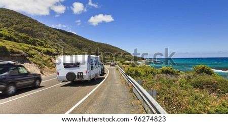 Great ocean road highway with lanes and cars passing near South ocean in Australia, Victoria, sunny summer day