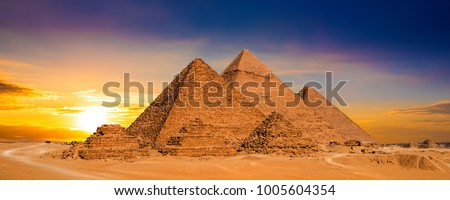 Great Pyramids of Giza, Egypt, at sunset #1005604354