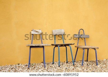 Great recycled  chairs design, with beautiful yellow hand painted wall background