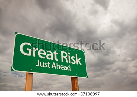 Great Risk Just Ahead Green Road Sign with Dramatic Storm Clouds and Sky.