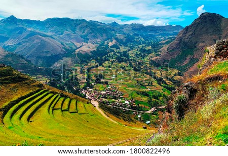 Great Sacred Valley of Inca in Peru. Ancient green agricultural terraces Andenes. Magnificent Andes mountains landscape. Peruvian countryside scene. View on Urubamba valley. Valle Sagrado de los Incas