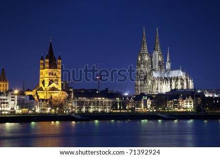 Great Saint Martin Church and Dom in Cologne at night, Germany