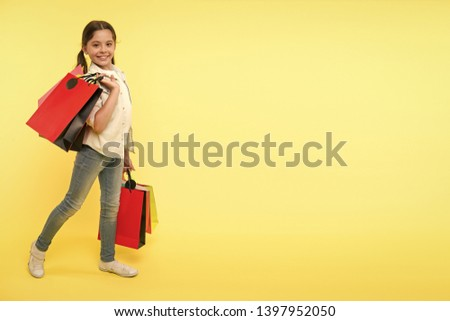 Great school shopping deals. Back to school season great time to teach budgeting basics children. Girl carries shopping bags. Prepare for school season buy supplies stationery clothes in advance.