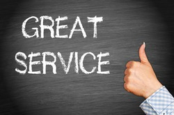 Great Service - female hand with thumb up and text on blackboard background