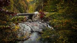 Great Smoky Mountains Autumn Road Trip. Bridge over the roadside Sinks waterfall on Little River Road in the Great Smoky Mountains National Park. Gatlinburg, Tennessee.
