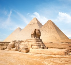 Great sphinx and pyramids under bright sun
