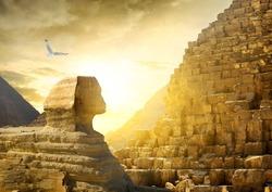 Great sphinx and pyramids under bright sun