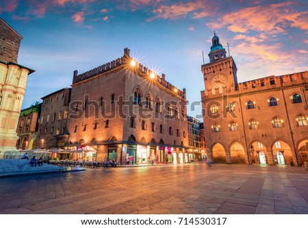 Great spring sunset of the main square of City of Bologna with Palazzo d'Accursio and facade of Basilica di San Petronio. Great cityscape of Bologna, Italy, Europe. Traveling concept background.