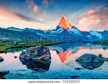 Great summer scene of the Stellisee lake. Splendid evening view of Matterhorn (Monte Cervino, Mont Cervin) in Swiss Alps, Switzerland, Europe. Beauty of nature concept background.