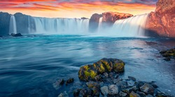 Great sunrise on Skjalfandafljot river, Iceland, Europe. Colorful summer view of Godafoss, spectacular waterfall plunging over a curved, 12m-high precipice, with paths to various viewpoints.