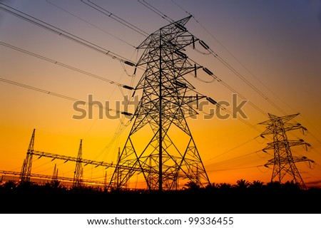 great sunset against pylon tower - stock photo
