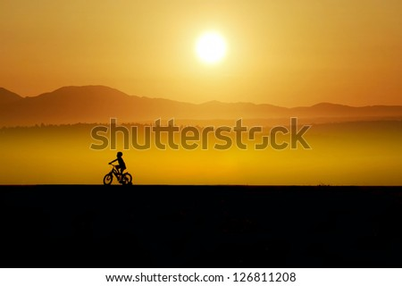 great sunset and boy silhouette