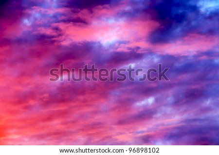 Great sunset sky with clouds all possible shades of pink and purple, great nature background.