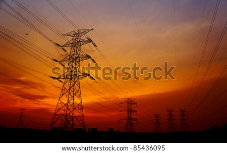 great sunset with pylon tower background - stock photo