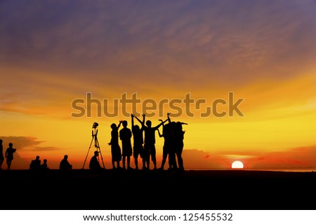 great sunset with silhouette people