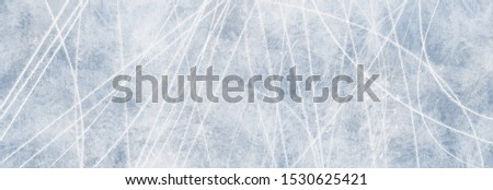 Great texture blue ice surface with scratches of skates as background for advertising surfaces in winter