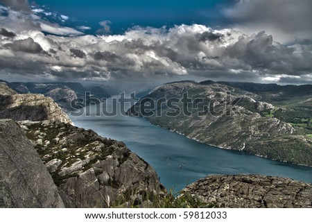 great view from a cliff in norway on the ice blue fjord waters