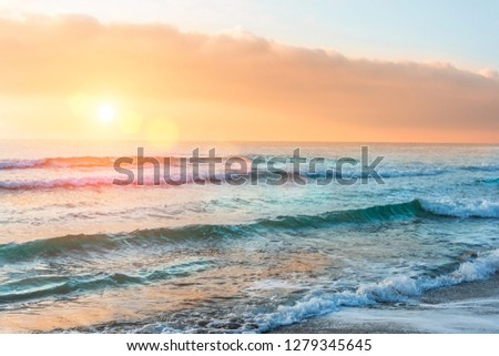 Great view of the ocean horizon and the waves of the beach at sunset #1279345645