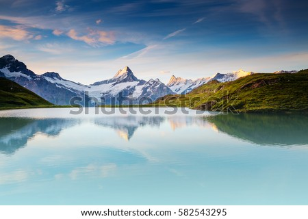 Great view of the snow rocky massif. Popular tourist attraction. Dramatic and picturesque scene. Location place Bachalpsee in Swiss alps, Grindelwald valley, Bernese Oberland, Europe. Beauty world. #582543295
