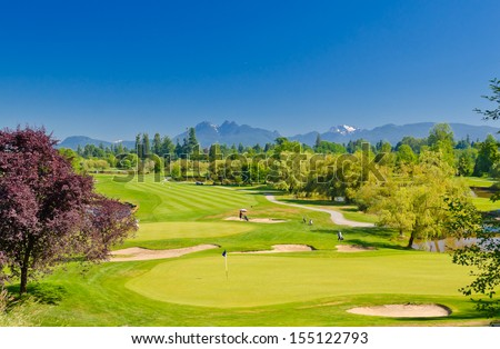Great view, outlook, panorama at the beautiful golf course with the mountains at the back. Canada, Vancouver.