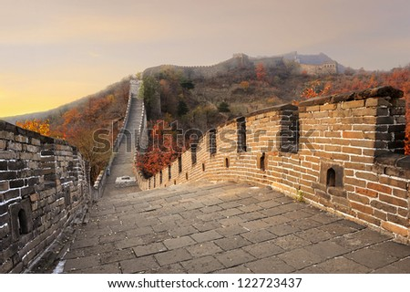 Great Wall of China in colorful Autumn season (Fall) during sunset