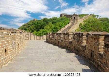 Great Wall of China in Summer with blue sky and some clouds