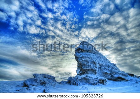 Great winter blue landscape with The Sphinx, a natural rock formation in the Mountains