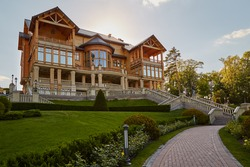 Great wooden mansion, log-house in park