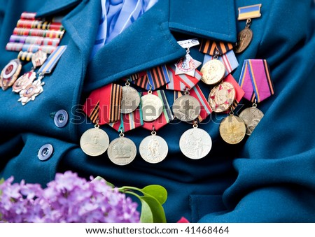 Great World War veteran with medals and lilac