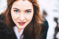 Great young woman portrait with blue eyes in winter