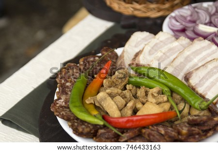 Greaves and meat products with hot peppers Stock photo ©
