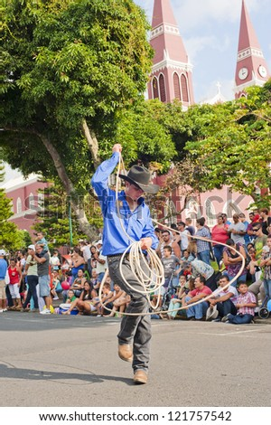 GRECIA, COSTA RICA-CIRCA DECEMBER 9:Cowboy performs rope tricks in Grecia circa December 9, 2012. Each December, El Tope is a rodeo style event with cowboys performing rope and riding tricks.