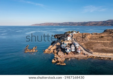 Greece. Ano Koufonisi island, Small Cyclades. Old shipyard for wooden fishing boats structure and repair. Aerial drone view. Traditional windmill and small church, calm sea, blue sky background Foto stock ©