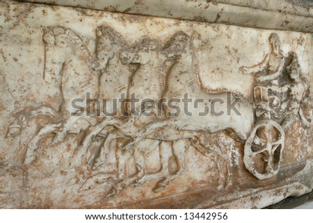 Greece, Athens. Ancient Agora. Ancient greek marble slab with the chariot represented on it.
