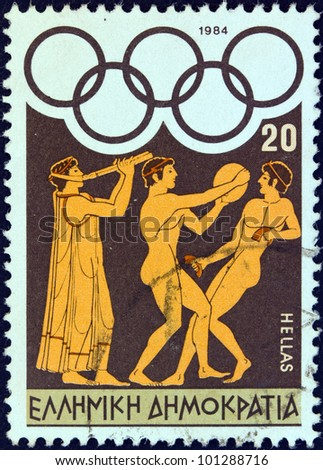 """GREECE - CIRCA 1984: A stamp printed in Greece from the """"Olympic Games, Los Angeles"""" issue shows flute player, discus thrower and long jumper, circa 1984."""
